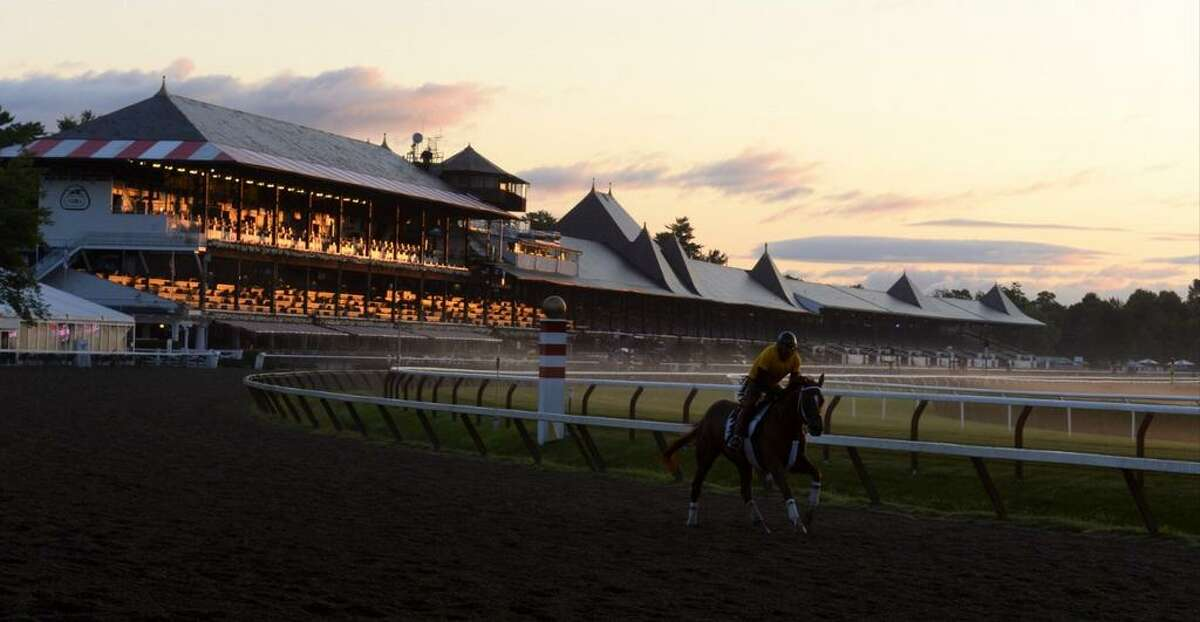 It was a beautiful morning at Saratoga Race Course Monday as mist moved over the main track while horses worked out. (Skip Dickstein / Times Union)