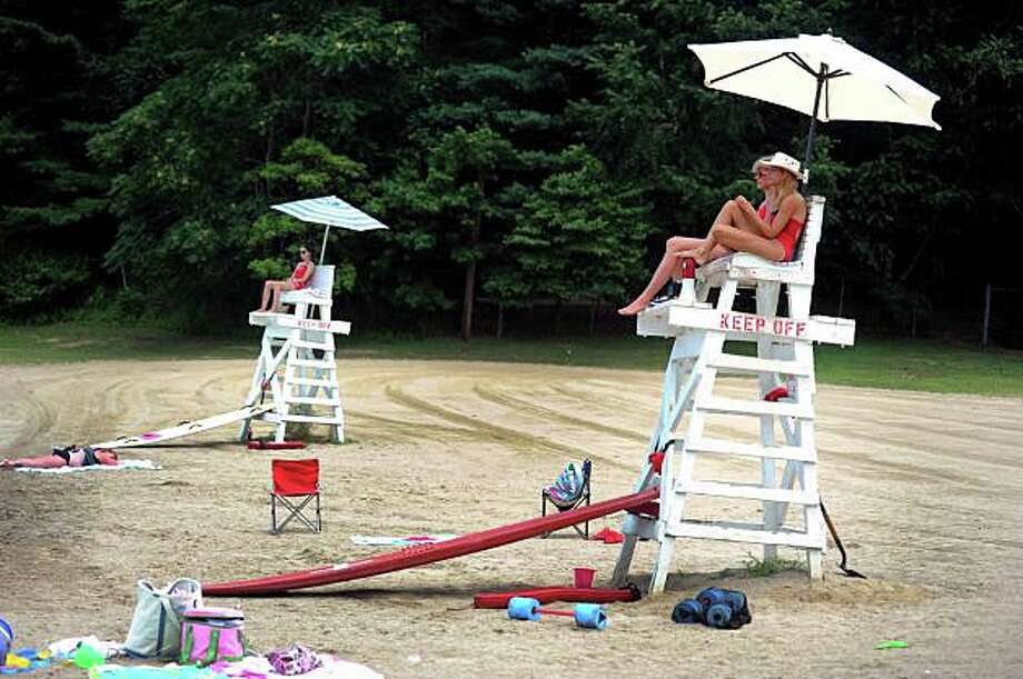 Lifeguard coverage at town beaches will begin to be scaled back this week as the summer season comes to an end. Photo: File Photo / Fairfield Citizen
