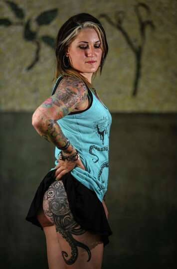 Heidi mclaughlin models her tattoos during the 13th annual for Houston tattoo expo