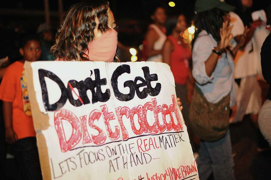 The protests in Ferguson, Mo., are borne of a host of inequalities.  Photo: Michael B. Thomas, AFP/Getty Images / 2014 AFP