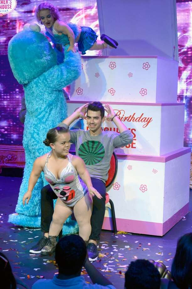 Recording artist Joe Jonas (C) celebrates his birthday onstage with cast of Beacher's Madhouse sponsored by Beau Joie Champagne and Casamingos Tequila at Beacher's Madhouse at the MGM Grand Hotel/Casino on August 15, 2014 in Las Vegas, Nevada. Photo: Bryan Steffy, WireImage