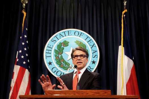 "Gov. Rick Perry: ""We don't settle political differences with indictments in this country,"" Perry said at a Capitol news conference on Saturday. ""This indictment amounts to nothing more than abuse of power, and I cannot and I will not allow that to happen."" Photo: Mengwen Cao, Associated Press / The Daily Texan"