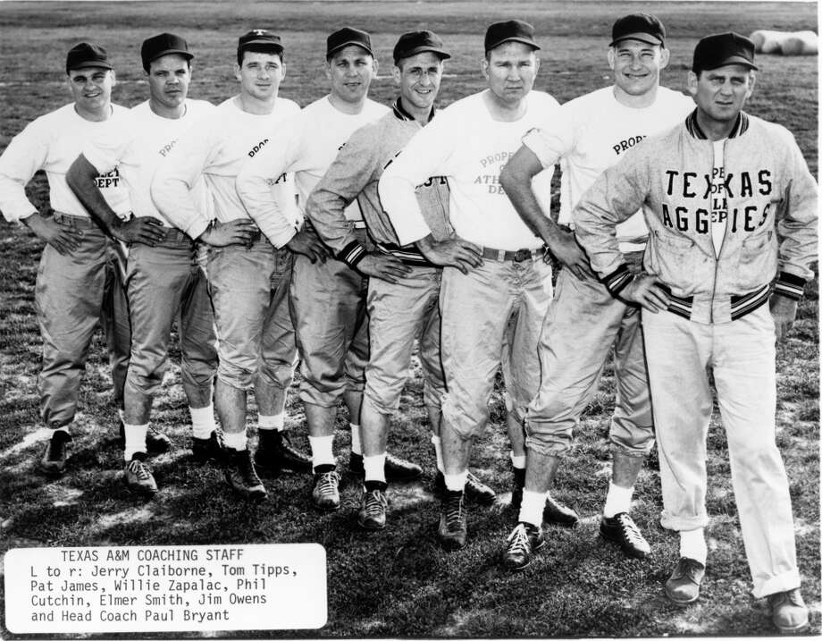 TEXAS A&M COACHING STAFF - (L-R) Jerry Claiborne, Tom Tipps, Pat James, Willie Zapalac, Phil Cutchin, Elmer Smith, Jim Owens and Aggies head coach Paul Bryant Photo: Houston Chronicle Files