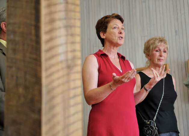 Artist Denise Saint-Onge, left, talks about her gallery during a press conference at the Denise Saint-Onge Visual Art gallery on Monday, Aug. 18, 2014, in Troy, N.Y. (Paul Buckowski / Times Union) Photo: Paul Buckowski / 00028212A