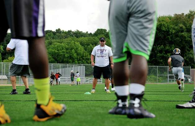 Head coach Mike Hurteau watches players runs through a drill during Troy High School football practice on Monday, Aug. 18, 2014 at Troy High School in Troy, N.Y.   (Paul Buckowski / Times Union) Photo: Paul Buckowski / 00028217A