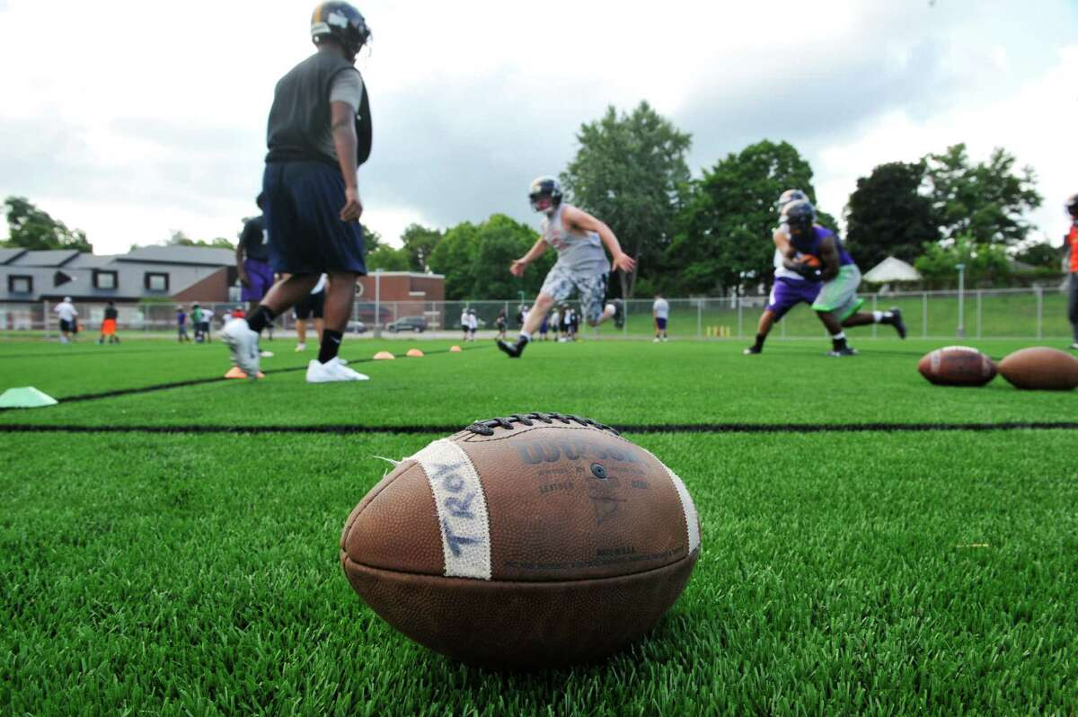Varsity players run through a drill during Troy High School football practice on Monday, Aug. 18, 2014 at Troy High School in Troy, N.Y. (Paul Buckowski / Times Union)