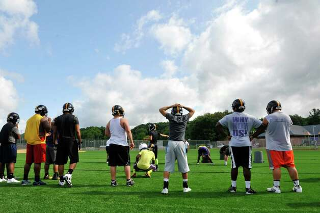 Varsity players watch as their teammates run through a drill during Troy High School football practice on Monday, Aug. 18, 2014 at Troy High School in Troy, N.Y.   (Paul Buckowski / Times Union) Photo: Paul Buckowski / 00028217A