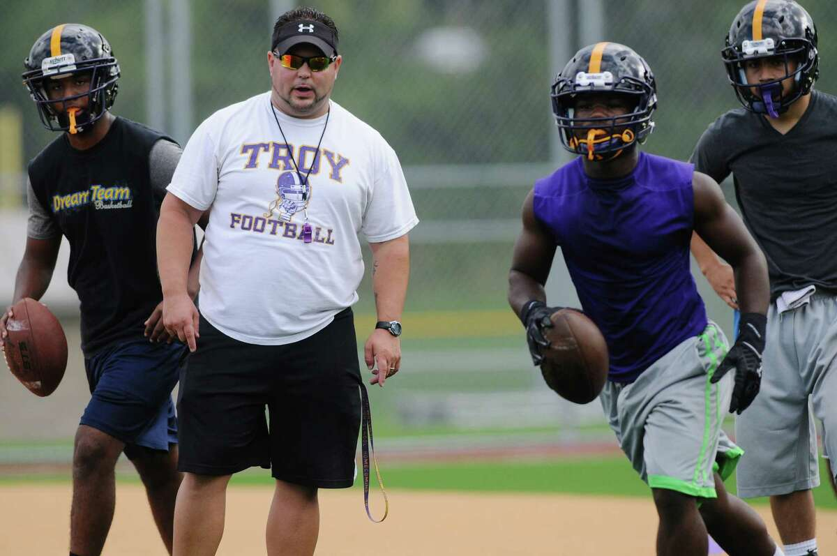 Head coach Mike Hurteau leads players through drills during Troy High School football practice on Monday, Aug. 18, 2014 at Troy High School in Troy, N.Y. (Paul Buckowski / Times Union)