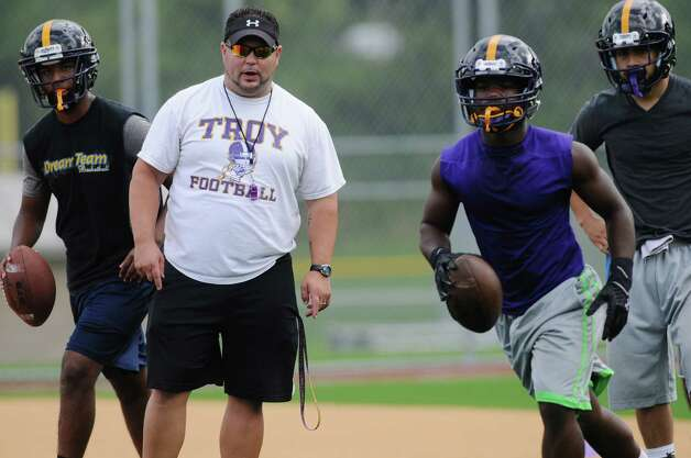Head coach Mike Hurteau leads players through drills  during Troy High School football practice on Monday, Aug. 18, 2014 at Troy High School in Troy, N.Y.   (Paul Buckowski / Times Union) Photo: Paul Buckowski / 00028217A