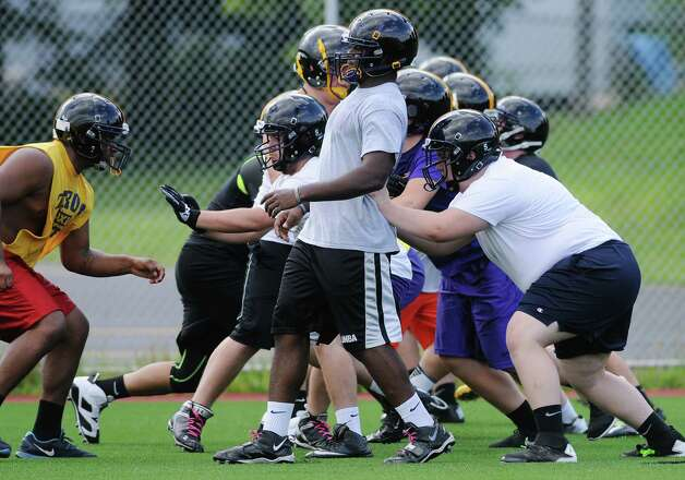 Linemen run through a drill during Troy High School football practice on Monday, Aug. 18, 2014 at Troy High School in Troy, N.Y.   (Paul Buckowski / Times Union) Photo: Paul Buckowski / 00028217A