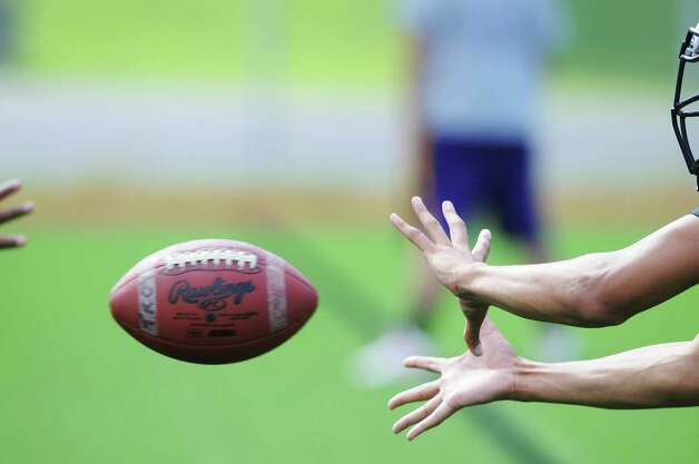 A player reaches out to catch a pass during Troy High School football practice on Monday, Aug. 18, 2014 at Troy High School in Troy, N.Y.   (Paul Buckowski / Times Union) Photo: Paul Buckowski / 00028217A