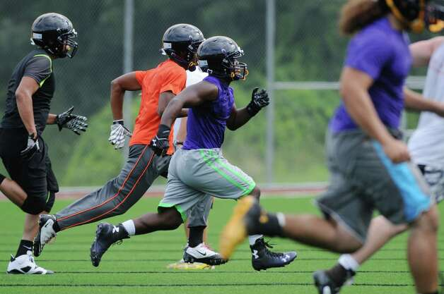 Players run sprints during Troy High School football practice on Monday, Aug. 18, 2014 at Troy High School in Troy, N.Y.   (Paul Buckowski / Times Union) Photo: Paul Buckowski / 00028217A