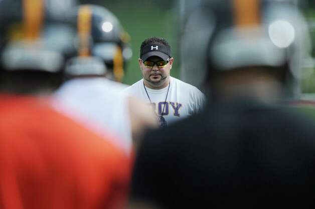 Head coach Mike Hurteau watches players run through a drill during Troy High School football practice Monday, Aug. 18, 2014, at Troy High School in Troy, N.Y.   (Paul Buckowski / Times Union) Photo: Paul Buckowski / 00028217A