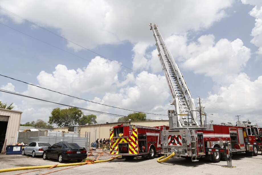 Firefighters battled a blaze just before noon Monday at a warehouse at 3824 Artdale near Westpark in southwest Houston. Photo: Cody Duty / Houston Chronicle