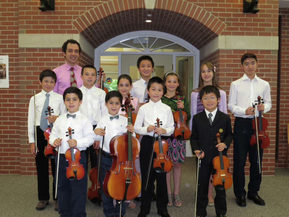 Yaroslav Kargin and his students recently presented the ninth annual recital at the Waveny Care Center. Bottom row from left, Peter Gabriel III, George Gabriel, Brandon Bao and Soma Narita; middle row, Kenzo Otsuka, Thomas Minar Jr., Elena Brennan, Nicole Satanovsky, Sofia Pronina and Saneyuki Matsuoka; top row, Yaroslav Kargin and Jordan Song. Photo: Contributed Photo, Contributed / New Canaan News Contributed