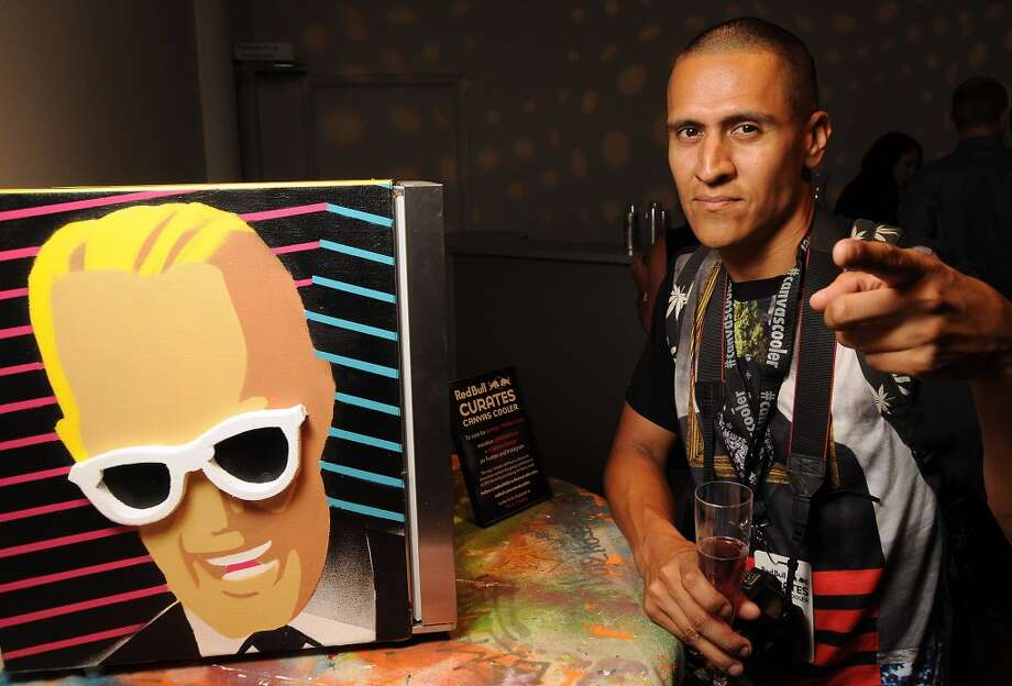 Artist Phillip Perez aka Article with his piece at a reception for the Red Bull Curates: The Canvas Cooler Project at Winter Street Studios Thursday Aug. 14, 2014. Photo: Dave Rossman, For The Houston Chronicle