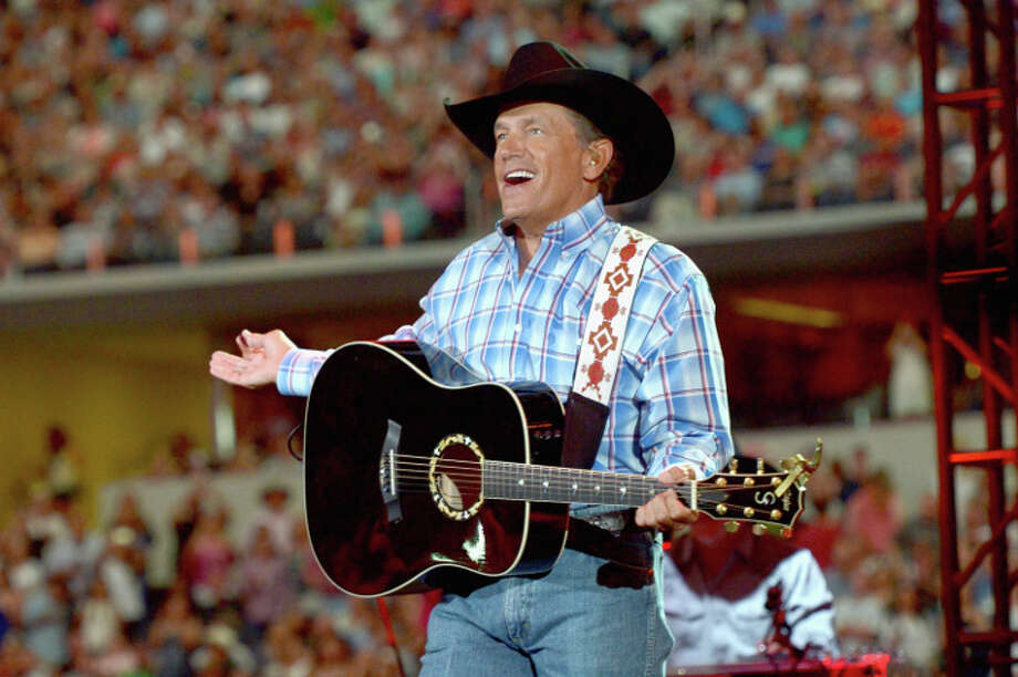 George Strait performs onstage at  AT&T Stadium. Photo: Rick Diamond, 2014 Getty Images / 2014 Getty Images