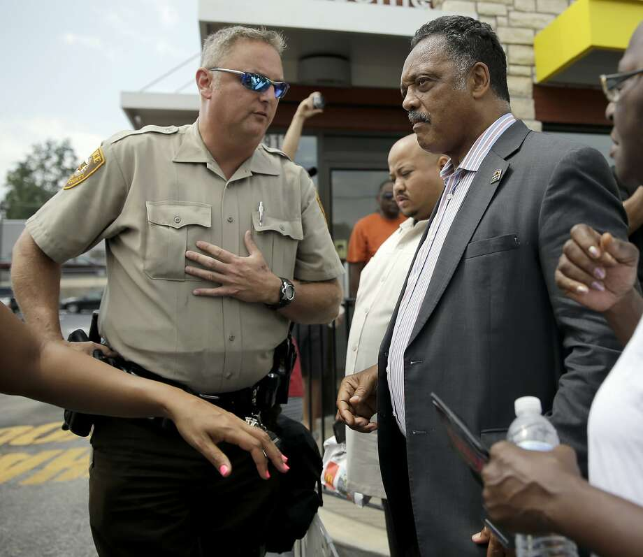 Civil rights leader Jesse Jackson visits a tense Ferguson, Mo. Photo: Jeff Roberson, Associated Press