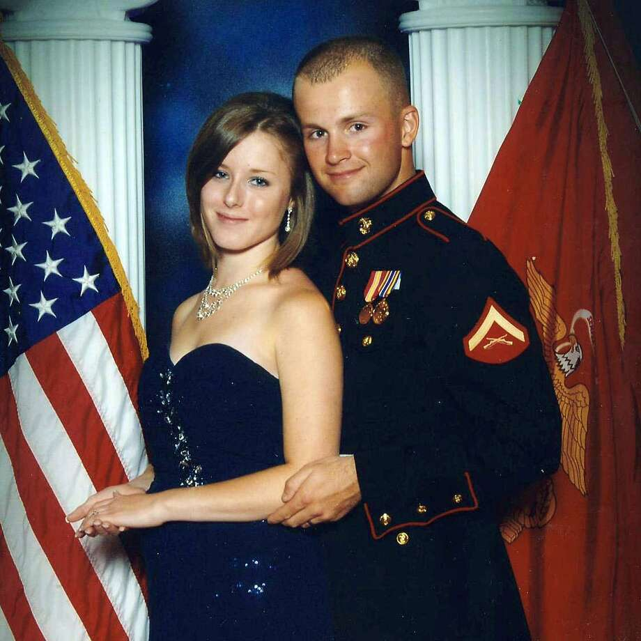 This undated photo provided by the San Bernardino County Sheriff's Department shows Erin Corwin with her husband, Cpl. Jonathan Corwin. Photo: Uncredited, Associated Press