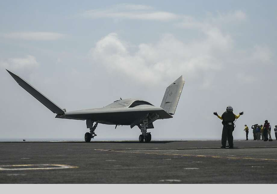 /The U.S. Navy's unmanned X-47B conducts flight operations aboard the aircraft carrier USS Theodore Roosevelt (CVN 71). The aircraft completed a series of tests demonstrating its ability to operate safely and seamlessly with manned aircraft. Operating alongside an F/A-18, the X-47B demonstrated two successful launch and recovery sequences. The Theodore Roosevelt is currently underway preparing for future deployments. Photo: Northrop Grumman Corp., Associated Press