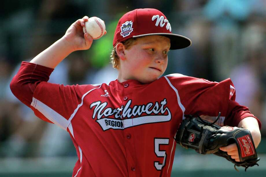 Lynnwood pitcher Logan Kruse (5) delivers during the first inning of an elimination baseball game against Pearland at the Little League World Series tournament in South Williamsport, Pa., Monday, Aug. 18, 2014. (AP Photo/Gene J. Puskar) Photo: Gene J. Puskar, Associated Press / AP