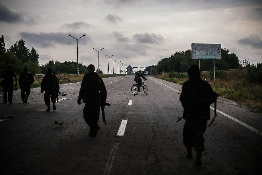 Pro-Russia rebels patrol along a road near Donetsk. The fighting in eastern Ukraine has forced nearly 344,000 people to flee their homes. Photo: Dimitar Dilkoff, AFP/Getty Images