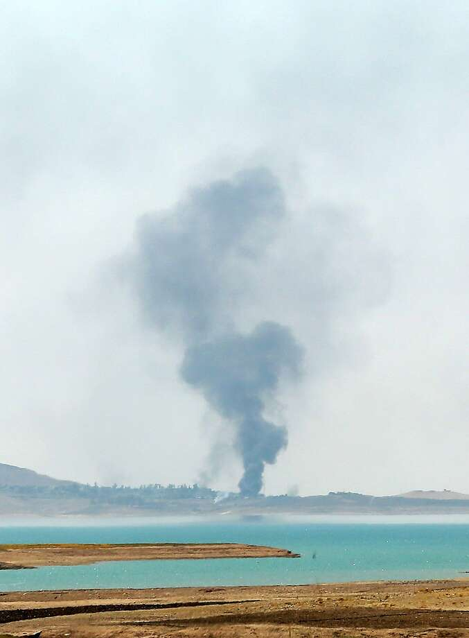 Smoke rises from air strikes against Islamic State militants at the Mosul Dam on the Tigris River. Photo: Khalid Mohammed, Associated Press