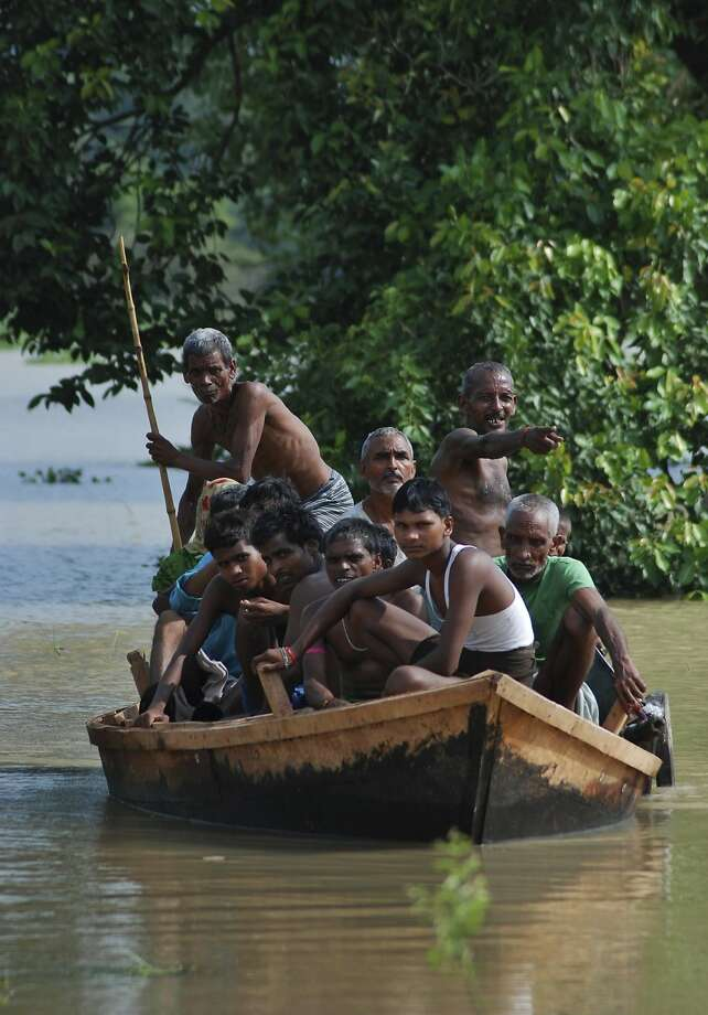 Residents of a flooded village search for a safer area in India's Uttar Pradesh state. Photo: Sanjay Sonkar, Associated Press