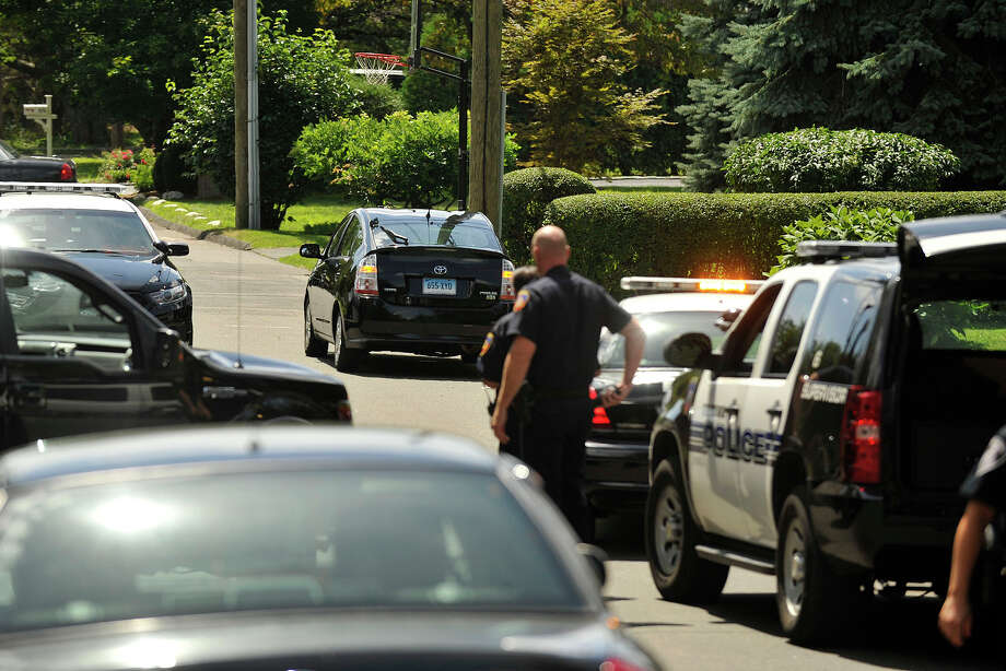 Stamford police apprehended the driver of a black Toyota Prius after it struck at least one vehicle in downtown Stamford, Conn., and led police on a chase which ended on a dead end road on Soundview Drive in the Cove section on Monday, Aug. 18, 2014. Photo: Jason Rearick / Stamford Advocate