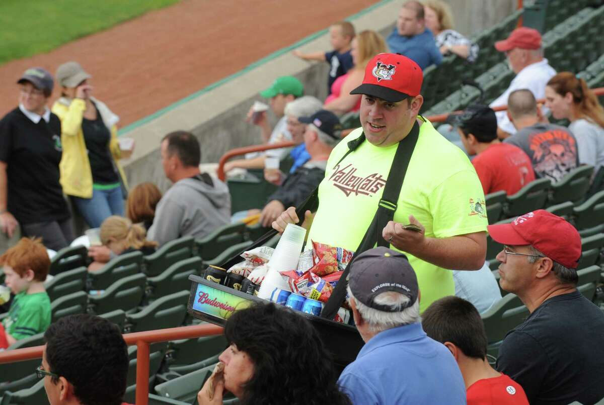 Beer hawker Joe LaVare works the crowd during theValleyCats baseball game against the Hudson Valley Renegades at Joe Bruno Stadium on Tuesday Aug.12, 2014 in Troy, N.Y. (Michael P. Farrell/Times Union)