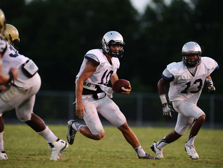 West Orange-Stark's Chase Rutledge, No. 10, and Grant Lapoint, No. 13, look for a way to advance the ball during Friday's scrimmage against Nederland. The West Orange-Stark and Nederland football teams scrimmaged Friday night at West Orange-Stark. Photo taken Friday 8/15/14 Jake Daniels/@JakeD_in_SETX Photo: Jake Daniels / ©2014 The Beaumont Enterprise/Jake Daniels