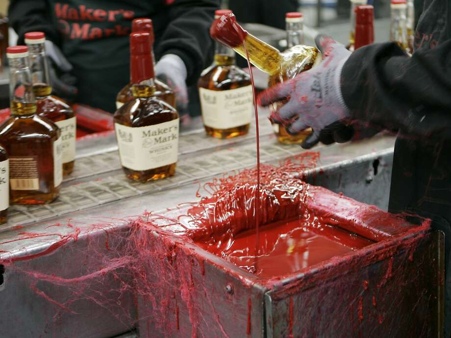 Maker's Mark bourbon of Loretto, Ky., the brand known for its red wax seal, has expanded its operations as demand for bourbon has risen in recent years. Photo: Ed Reinke, Associated Press