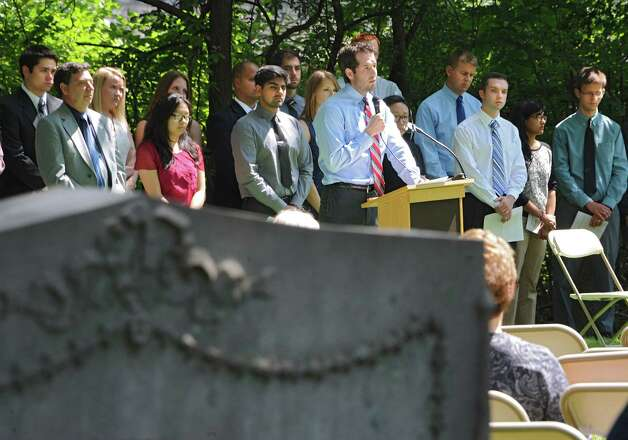 Adam Parker speaks on behalf of the class of 2017 as medical students and faculty from Albany Medical College and family members attend a ceremony at Albany Rural Cemetery Monday, Aug. 18, 2014 in Menands, N.Y. The ceremony paid tribute to 335 people who died and donated their bodies to the Medical College's Anatomical Gift Program for medical education. (Lori Van Buren / Times Union) Photo: Lori Van Buren / 00028197A