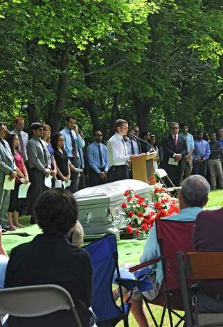 Steve Lange speaks on behalf of the class of 2017 as medical students and faculty from Albany Medical College and family members attend a ceremony at Albany Rural Cemetery Monday, Aug. 18, 2014 in Menands, N.Y. The ceremony paid tribute to 335 people who died and donated their bodies to the Medical College's Anatomical Gift Program for medical education. (Lori Van Buren / Times Union) Photo: Lori Van Buren / 00028197A