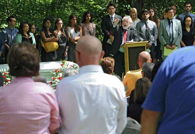 Rev. Harlan Ratmeyer, manager pastoral care/ACPE supervisor Albany Medical Center, delivers a homily as medical students and faculty from Albany Medical College and family members attend a ceremony at Albany Rural Cemetery Monday, Aug. 18, 2014 in Menands, N.Y. The ceremony paid tribute to 335 people who died and donated their bodies to the Medical College's Anatomical Gift Program for medical education. (Lori Van Buren / Times Union) Photo: Lori Van Buren / 00028197A