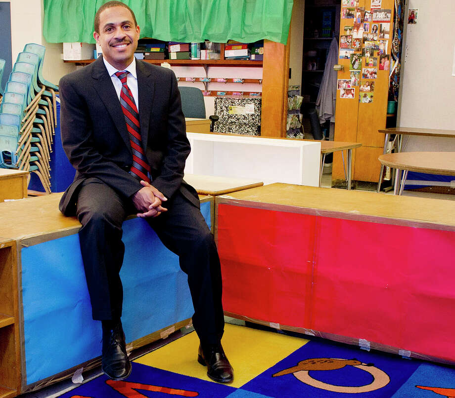 Northeast Elementary School Principal Hubert Gordon poses for a photo in the school in Stamford, Conn., on Thursday, August 14, 2014. Photo: Lindsay Perry / Stamford Advocate