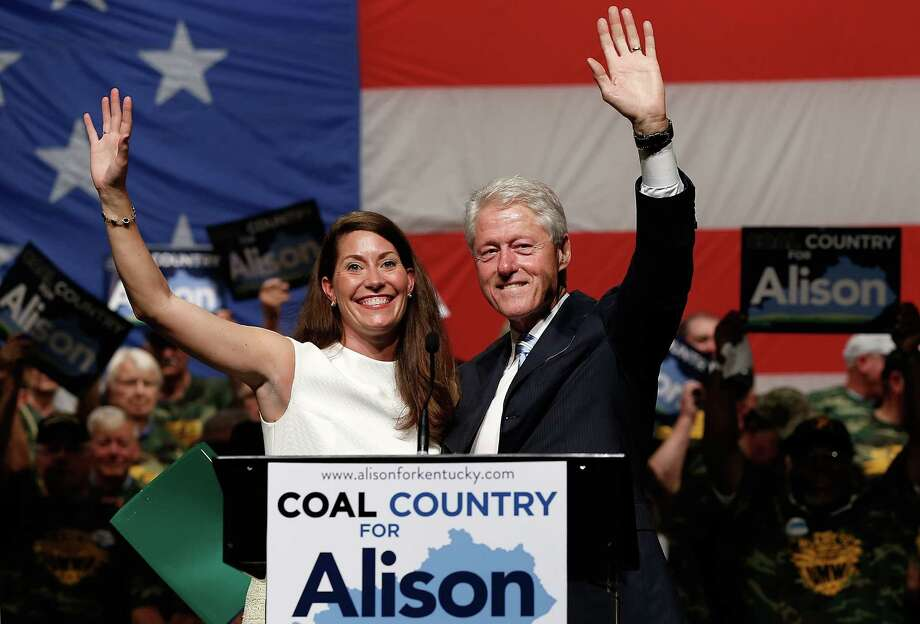 LEXINGTON, KY - AUGUST 06: U.S. Senate Democratic candidate and Kentucky Secretary of State Alison Lundergan Grimes campaigns with former U.S. President Bill Clinton at an event where they addressed members of the United Mine Workers of America August 6, 2014 in Lexington, Kentucky. Grimes recently received the endorsement of the UMWA and a recent 'Bluegrass Poll' by the Louisville Courier-Journal shows Grimes in a virtual tie with the incumbent, Senate Republican Leader Mitch McConnell (R-KY). (Photo by Win McNamee/Getty Images) ORG XMIT: 505569777 Photo: Win McNamee / 2014 Getty Images