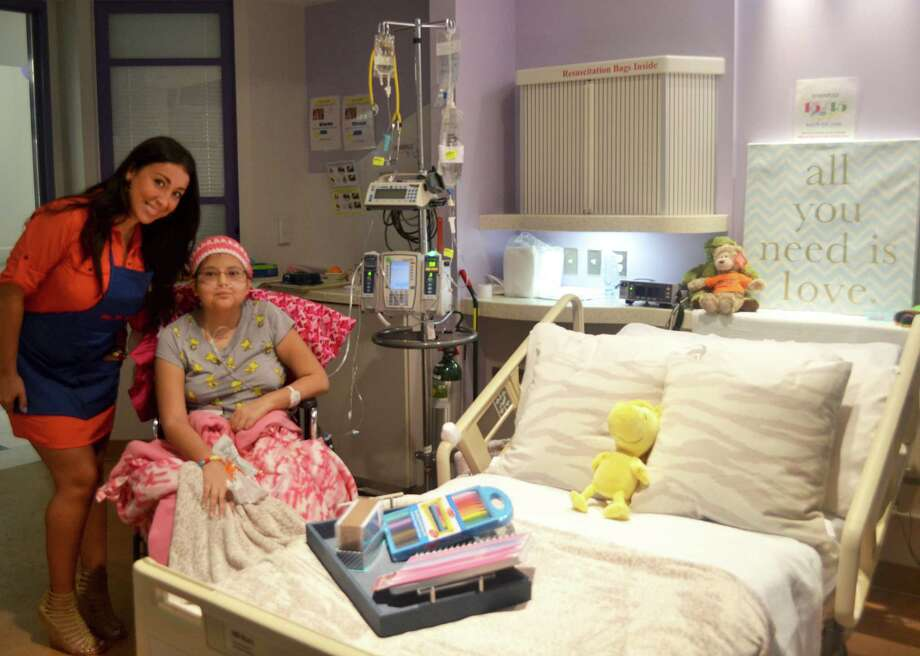 Interior designer Ashlina Kaposta, known as The Decorista, brightened up the room of a 16-year-old girl at Texas Children's Hospital. Kaposta's contribution was arranged through the Houston nonprofit Dec MyRoom with a $250 gift card provided by HomeGoods, a home furnishing store. Photo: Susie DeGraff