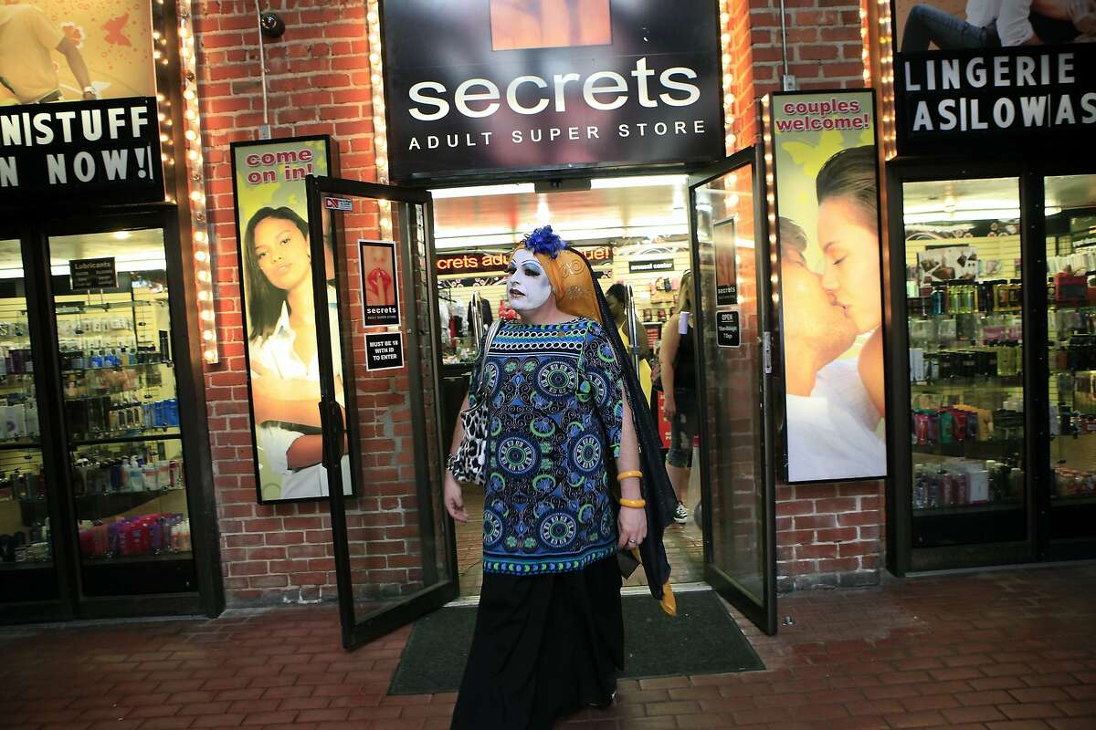 Sister Selma Soul of the Sisters of Perpetual Indulgence walks out of Secrets adult store during a Pop Up Gay Bar pub crawl event in Oakland, CA, Saturday, August 16, 2014.