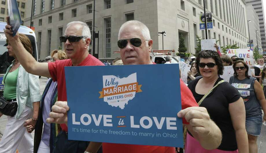 Gay marriage supporters march earlier this month in Cincinnati. The U.S. Supreme Court will have the final say on same-sex marriage. Let's hope freedom and family values triumph. Photo: Al Behrman / Associated Press / AP