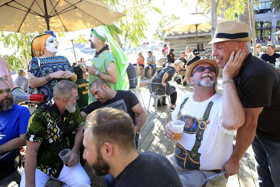 Patrons mingle as Pop-Up Gay Bar takes over Heinold's First and Last Chance Saloon at Jack London Square in Oakland. Photo: Michael Short, The Chronicle