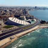 The enormous Bibliotheca Alexandrina in Alexandria, Egypt, was inaugurated in 2002 near the site of the original Library of Alexandria, built by the Greeks in the 3rd century BC. The building was designed by the Norwegian firm Snøhetta, which is handling the expansion of the San Francisco Museum of Modern Art.