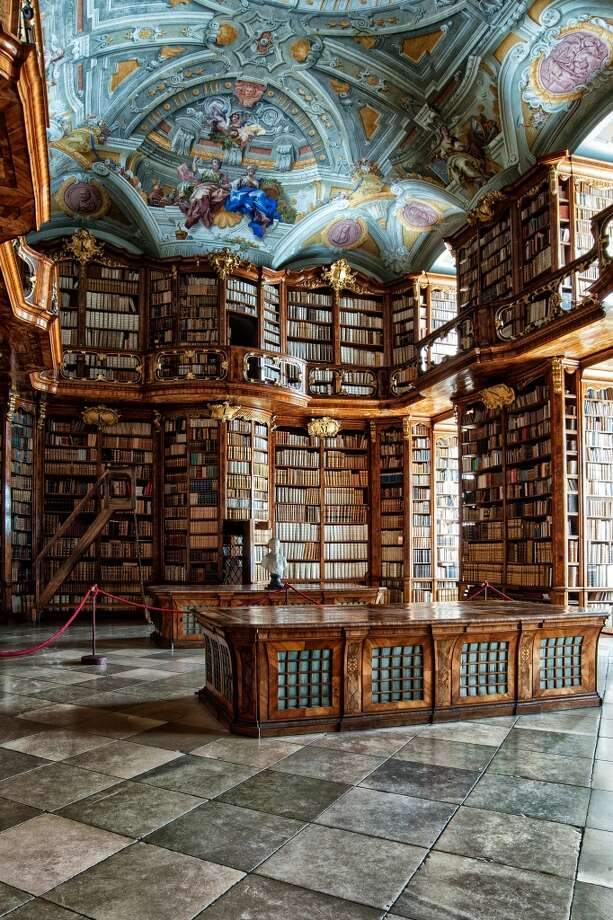 Carved-wood bookcases and a ceiling fresco dominate the Baroque library of the St. Florian Monastery, in Austria. Photo: Wolfgang Grilz, Flickr Vision