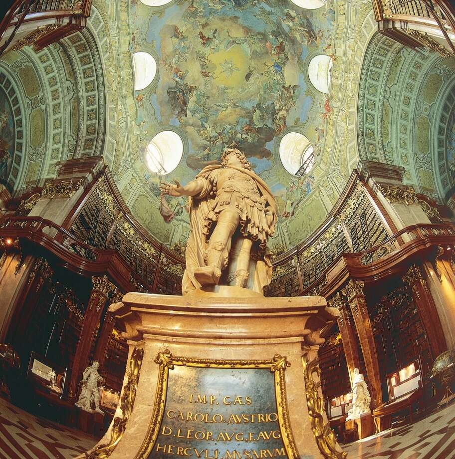 Marble statues and ceiling frescoes adorn the Baroque State Hall of the Austrian National Library in Vienna, completed in 1730. Photo: Imagno, Getty Images
