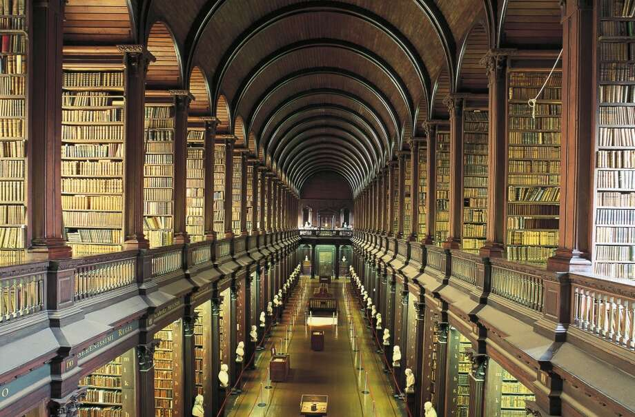 The very handsome Long Room of Trinity College's Old Library, in Dublin, Ireland, holds roughly 200,000 books. Photo: DEA / W. Buss, De Agostini/Getty Images