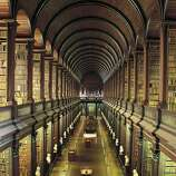 The very handsome Long Room of Trinity College's Old Library, in Dublin, Ireland, holds roughly 200,000 books.