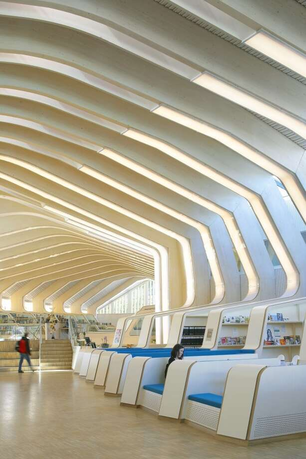 Norway's sleek Vennesla Library, completed in 2011, is lined with 27 wooden ribs. Photo: View Pictures, UIG Via Getty Images