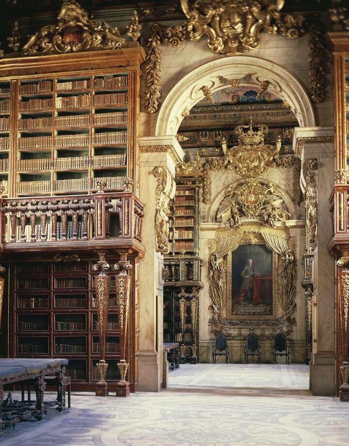 The ornate Joanina Library of the University of Coimbra General Library, in Portugal, was completed in 1728. Bats in the library feast on insects that would otherwise eat away at the books. Photo: DEA / G. Dagli Orti, De Agostini/Getty Images