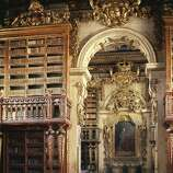 The ornate Joanina Library of the University of Coimbra General Library, in Portugal, was completed in 1728. Bats in the library feast on insects that would otherwise eat away at the books.