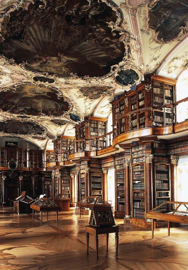 Switzerland's Rococo Abbey Library of St. Gall is one of the world's oldest libraries, with manuscripts that date as far back as the 8th century. Photo: DEA / S. Vannini, De Agostini/Getty Images